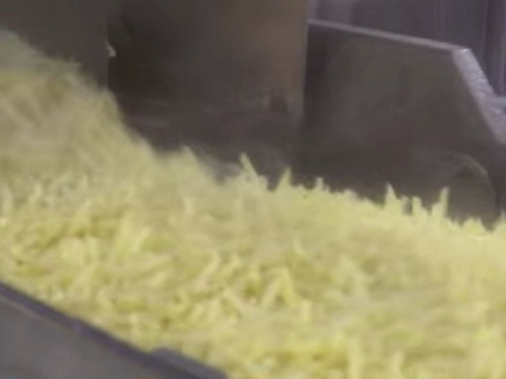 PHOTO: French fries are seen in an ingredient bath in this video released by McDonalds showing how their food is made.
