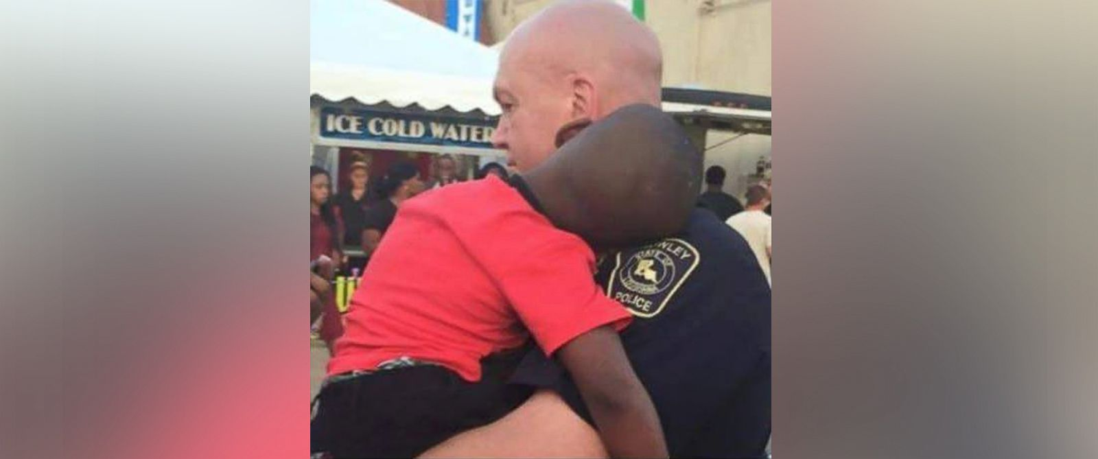 PHOTO: Crowley, Lousiana police officer, David Taylor, holds a young lost boy at a town festival.