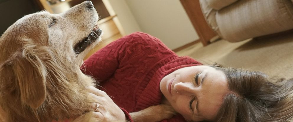 "PHOTO: Owner Bev is pictured with her dog ""Suzie."""
