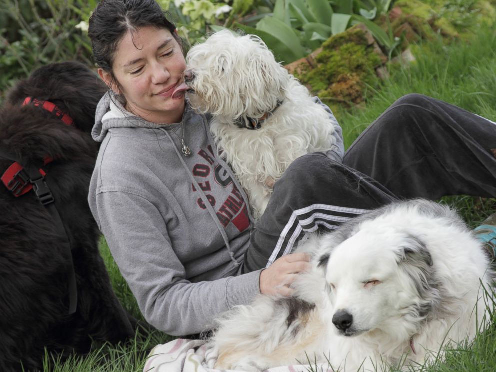 PHOTO: Owner Trisha is photographed with her dog Magoo, a blind and deaf therapy dog.