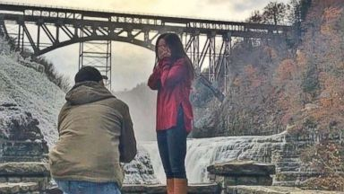 'PHOTO: Kayleigh Fahey said yes after her boyfriend James Regatuso popped the question on Nov. 12, 2017 inside Letchworth State Park in Castile, N.Y.' from the web at 'http://a.abcnews.com/images/Lifestyle/james-regatsuso-kayleigh-fahey-proposal-3-ht-jt-171118_16x9t_384.jpg'