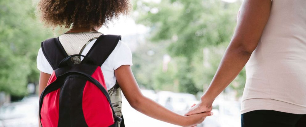 PHOTO: A mom and daughter hold hands while walking to school in this undated file photo.