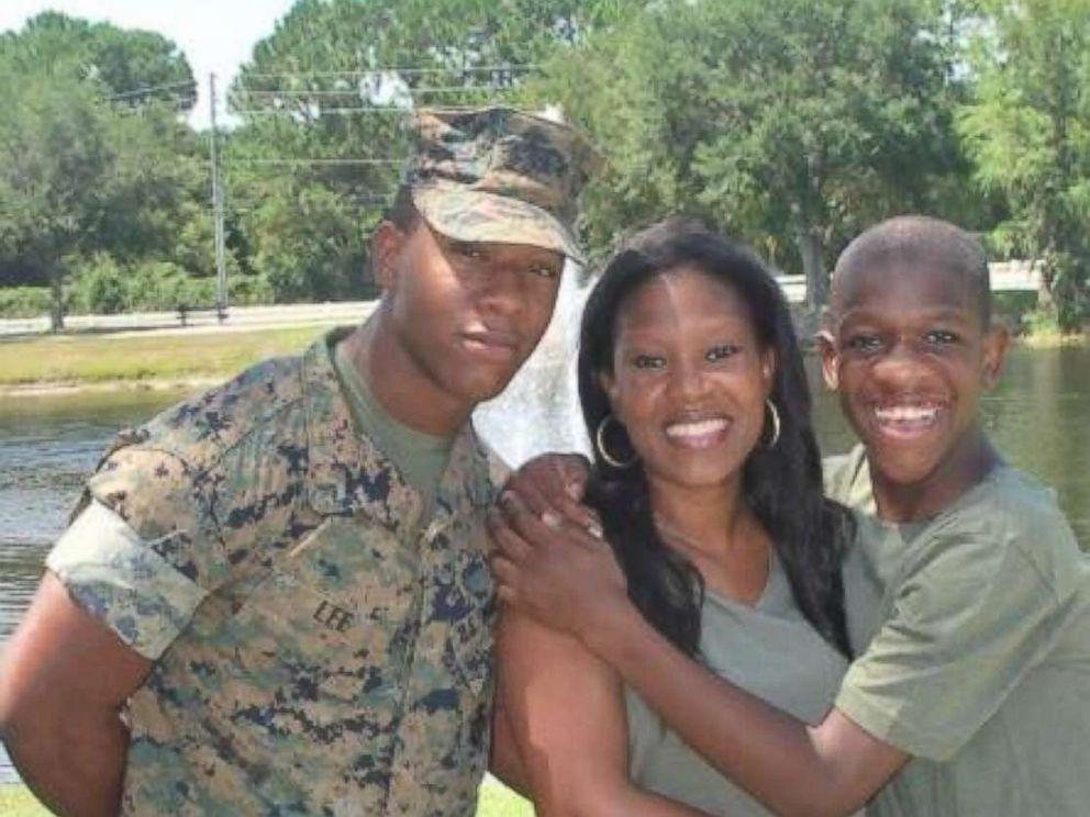 PHOTO: Rekita Lee smiles alongside her two sons, TreVaughn and Kordell Lee.