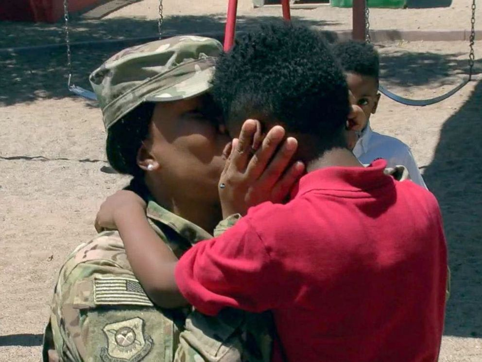 PHOTO: Shania Porter embraces her son Bryce, 5, Crown Charter School in Maricopa County, Arizona, on the afternoon of Aug. 7.