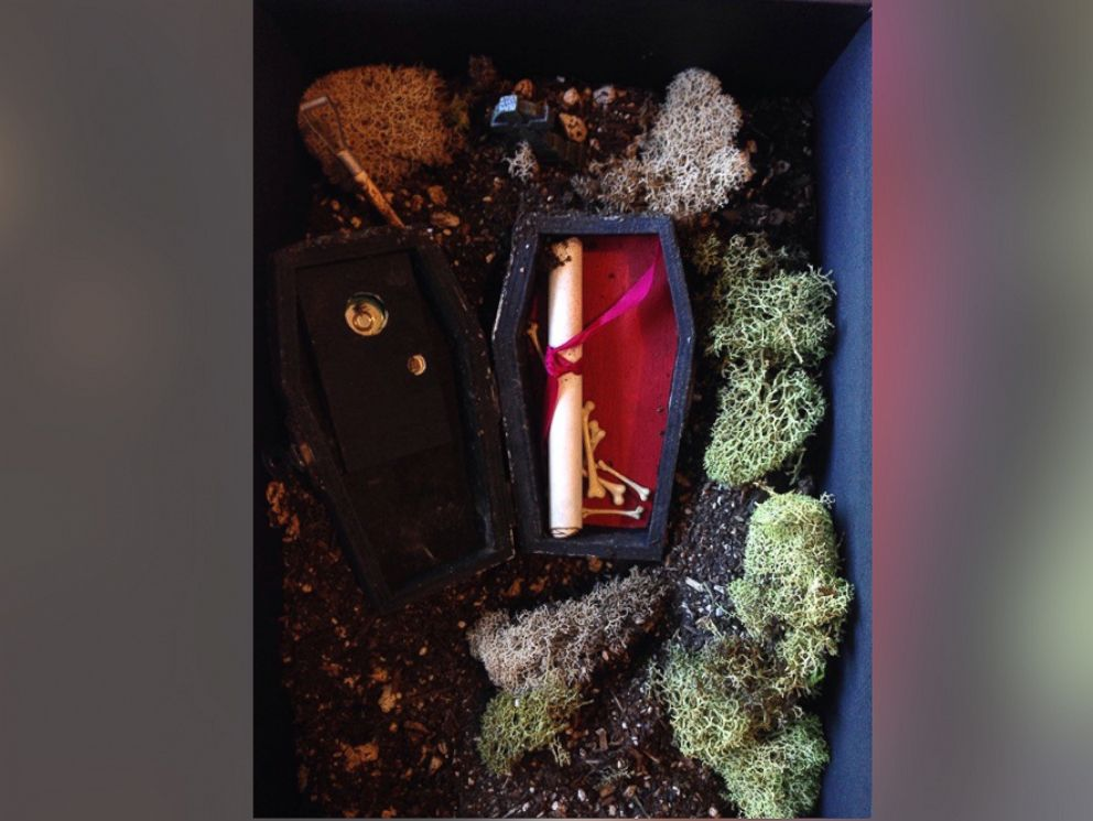 PHOTO: Cutler, a florist, hand-painted little coffins and buried them in potting soil inside a black photo box.