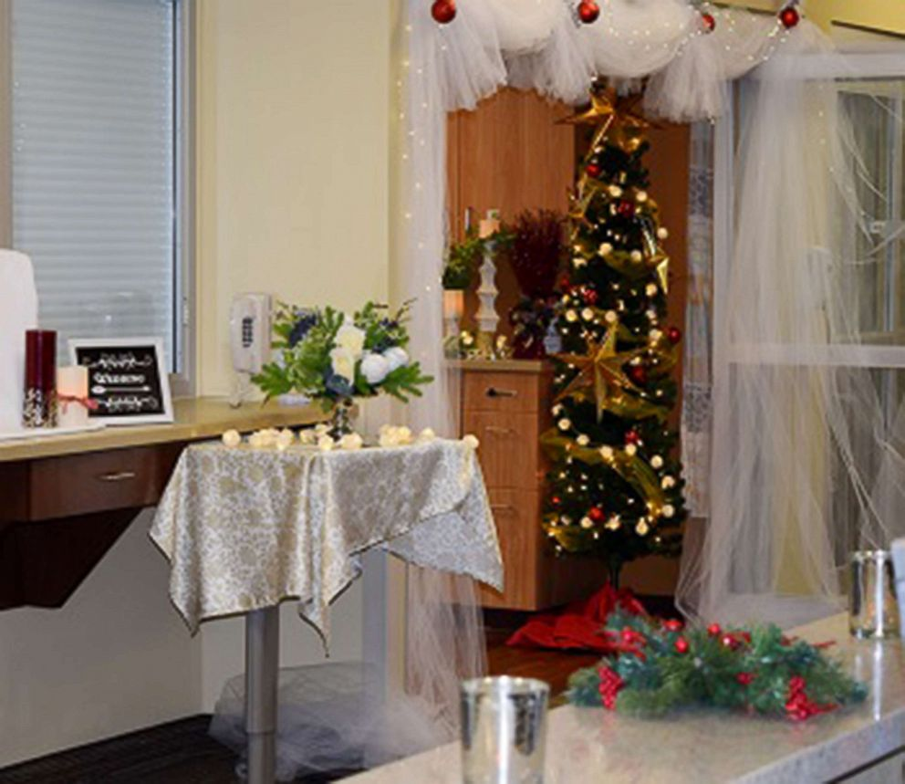 PHOTO: Employees at St. Lukes Magic Valley Medical Center in Twin Falls, Idaho, transformed a waiting area into a wedding venue.