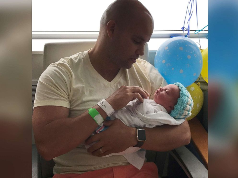 PHOTO: Michael Chuppa holds his newborn son, Blake, born July 10, 2017 at Hillcrest Hospital. Baby Blake is sporting a knit cap created by Barbara Lowe.