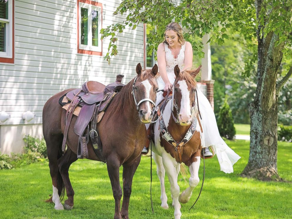 PHOTO: Patti Womer, 21, seen riding on her horse Cricket as her horse Dutch rode along side her on her wedding day, Sept. 9, 2017.