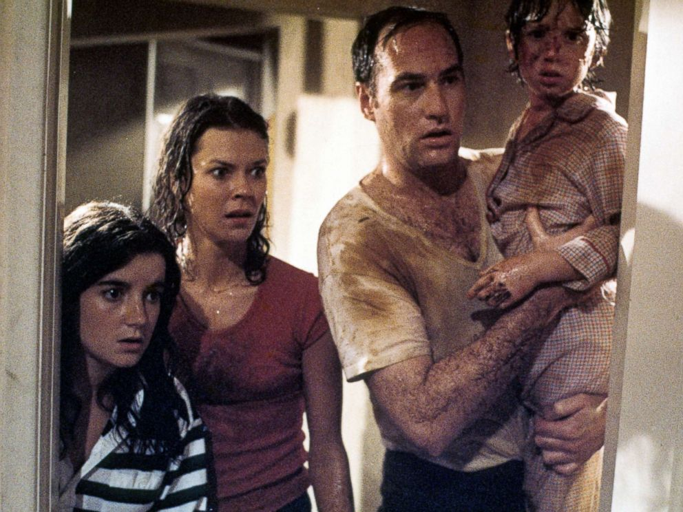 PHOTO: JoBeth Williams looks on as Craig T Nelson holds Oliver Robins in a scene from the film Poltergeist, 1982.