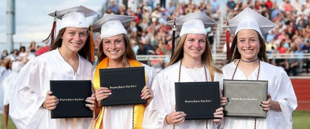 PHOTO: Rachel Murphy, Kelly Murphy, Erin Murphy and Casey Murphy, left to right, pose together at their 2017 high school graduation.