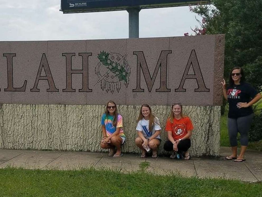 PHOTO: Rachel Murphy, Kelly Murphy, Erin Murphy and their older sister, Lyn Murphy, left to right, pose together at Oklahoma State University.