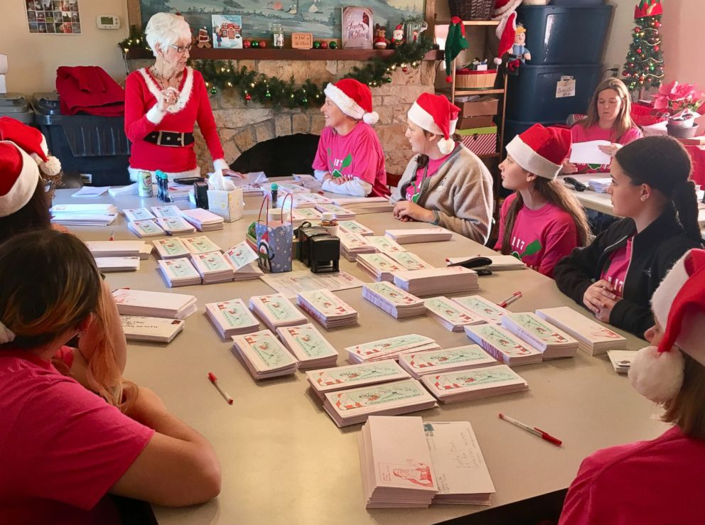 PHOTO: Pat Koch, standing, instructs volunteers in Santa Claus, Indiana.