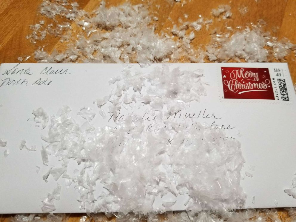 PHOTO: The Calverts are acting as Mr. and Mrs. Claus, handwriting replies to each child who drops off a letter.