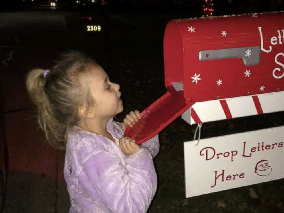 PHOTO: Dylann Dutton peeks inside the magical Letters to Santa mailbox.