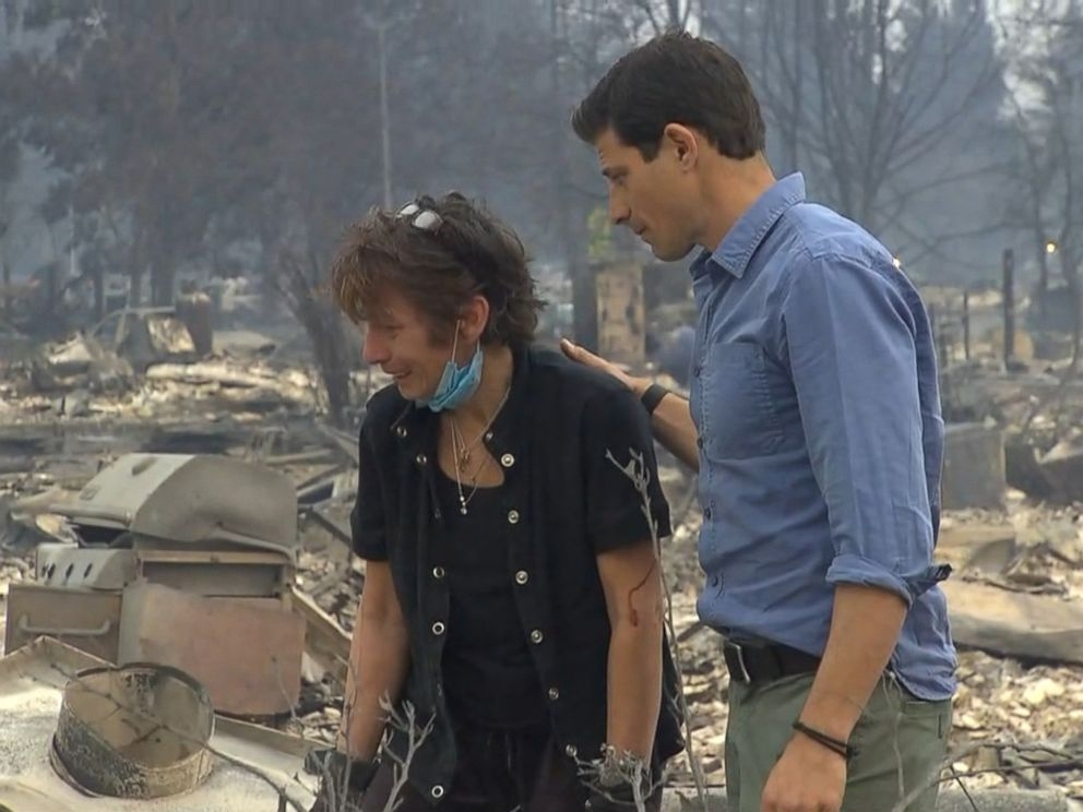 PHOTO: ABC News Matt Gutman comforted Kris Pond as she searched for her wedding ring in the ashes and debris where her home once stood in northern California.