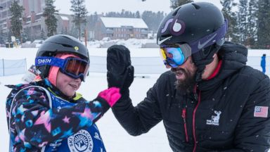 'PHOTO: Lilly Biagini, 10, gives Keith Gabel, a U.S. Paralympian, a high five.' from the web at 'http://a.abcnews.com/images/Lifestyle/skier-6-ht-er-171211_16x9t_384.jpg'