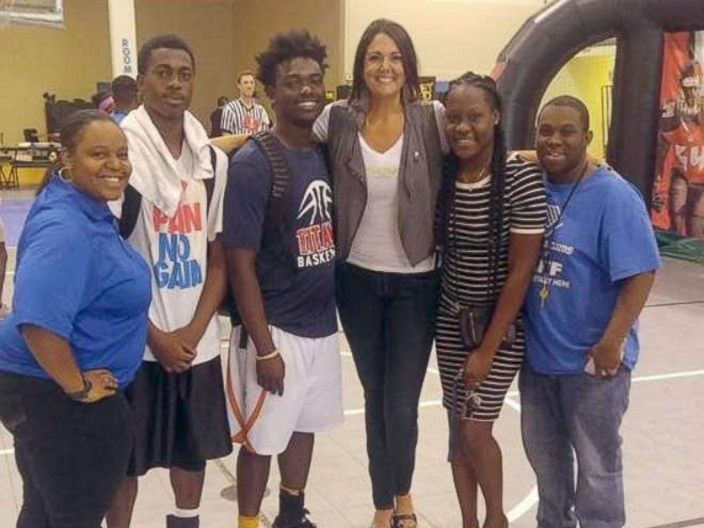 PHOTO: Carolynn Smith of Tampa poses with her mentees from the Boys and Girls Club.