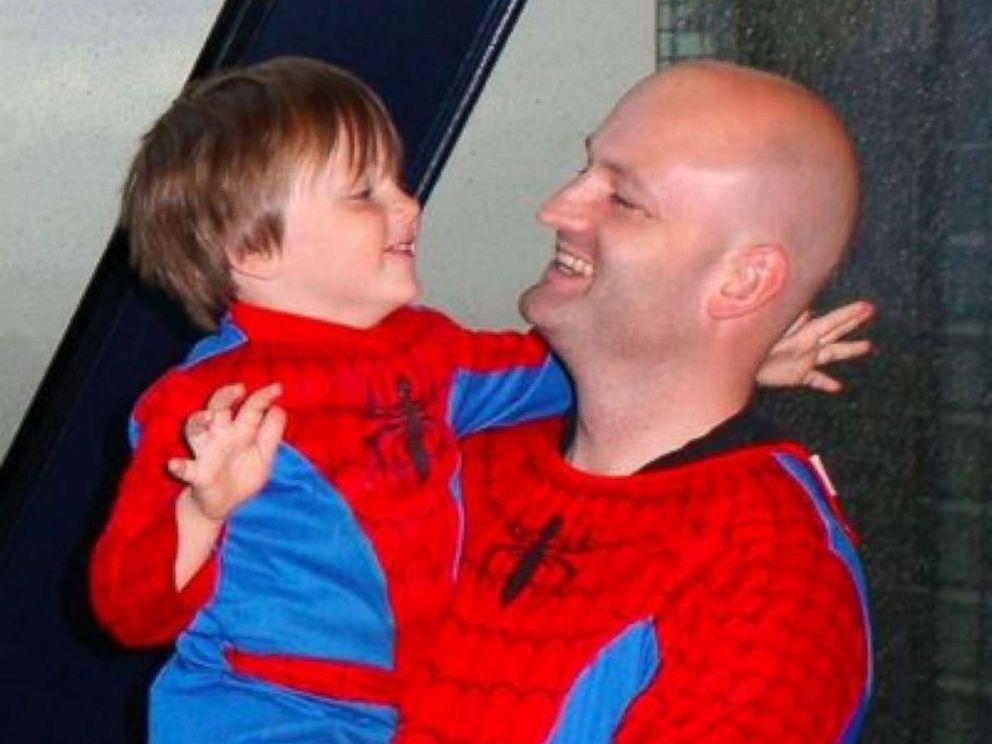 PHOTO: Sam Warren, 8, with his father Henry Warren