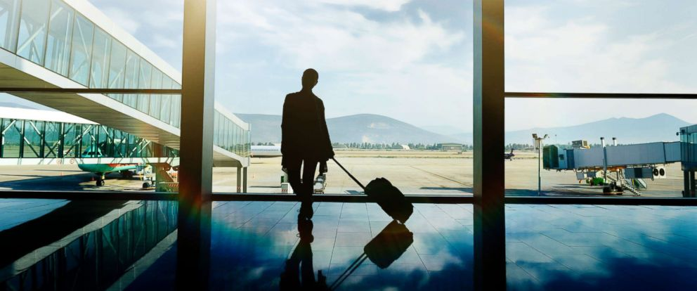 PHOTO: A traveler waits at the airport with luggage in this undated stock photo.