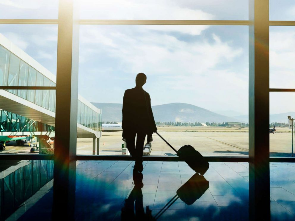 photo a traveler waits at the airport with luggage in this undated stock photo