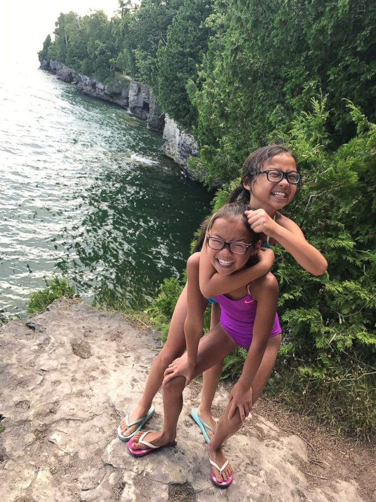 PHOTO: Reunited twin sister Audrey Doering and Gracie Rainsberry have fun together on a joint family trip this summer.