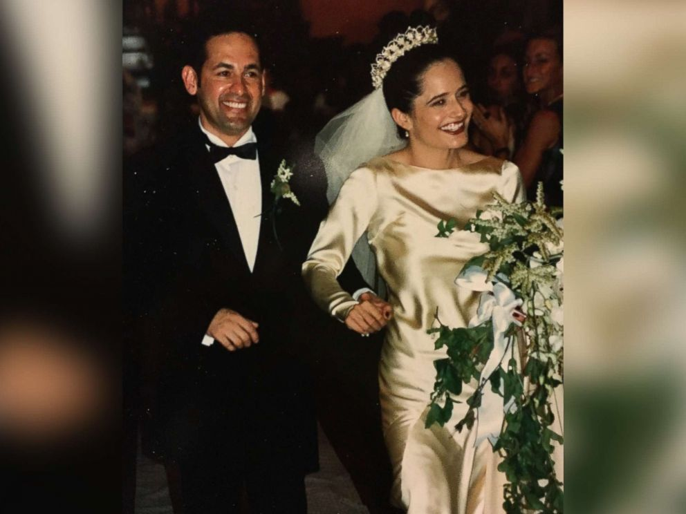 PHOTO: Elena Salinas and Ric Salinas walk down the aisle on their wedding day in 1997.