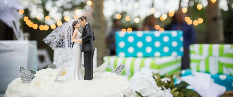 PHOTO: A bride and groom cake topper is pictured on a cake in this undated stock photo.
