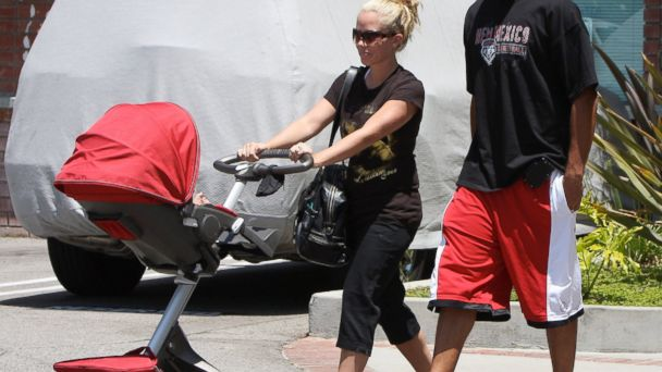 PHOTO: Kendra Wilkinson is seen with her husband Hank Baskett with their son in a Stokke Xplory stroller in Beverly Hills, Calif. on June 22, 2010.