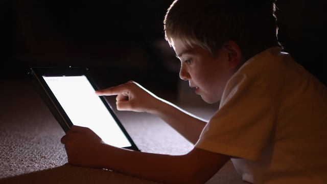 PHOTO: A ten-year-old boy uses an Apple Ipad tablet computer, Knutsford, United Kingdom, Nov. 29, 2011.