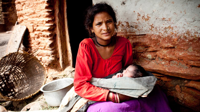 PHOTO: Maheshwori Devi Bishwokarma, 19, with her newborn daughter, Seema, in Dikha Village, Nepal.