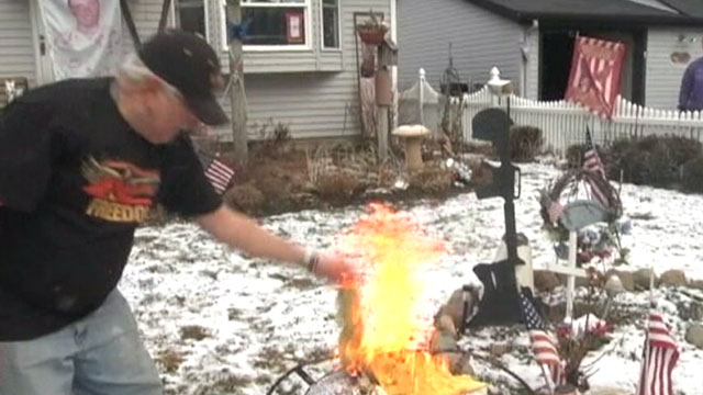 PHOTO: John Burri burned the New Jersey flag on his outdoor grill in protest.
