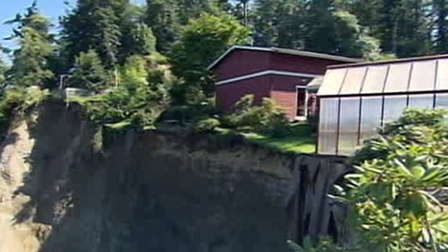 PHOTO: The front yard of a home in Washington has been crumbling away leaving the home in jeopardy of plummeting down a 200-ft. cliff.