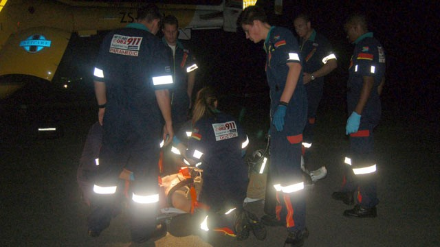PHOTO: Paramedics treat Oscar Pistorius on Feb. 22, 2009 in Johannesburg, South Africa after he sustained facial injuries in a boating accident on the Vaal River.