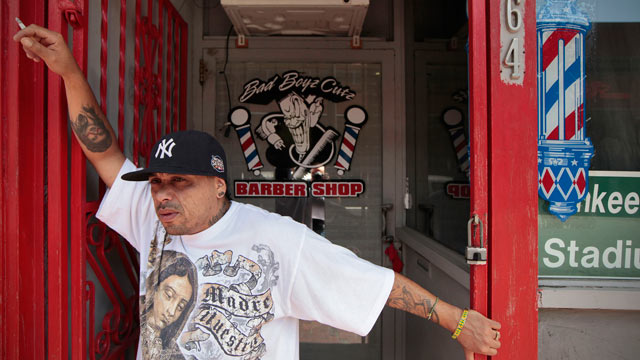PHOTO: William Camacho, who practices Palo Mayombe, stands in front of his barber shop in downtown New Bedford.