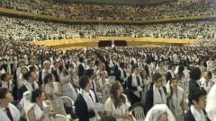 VIDEO: Followers of the late Rev. Sun Myung Moon believe international marriages promote world peace.