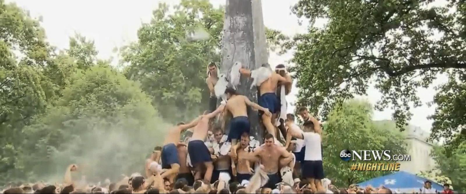 VIDEO: Naval Academy freshman climb obelisk covered in lard in annual tradition