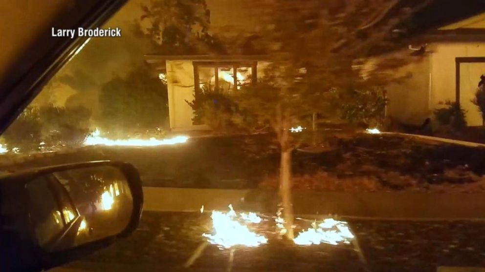 Wildfires cause Californians to flee, sift through burned homes