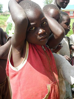 Uganda is approximately the size of Oregon, and  it has a population of about 26 million people.  In internally displaced person's camps, also known as IDP camps,  there are about 1.7 million people. Here's a child at the Awach IDP Camp.