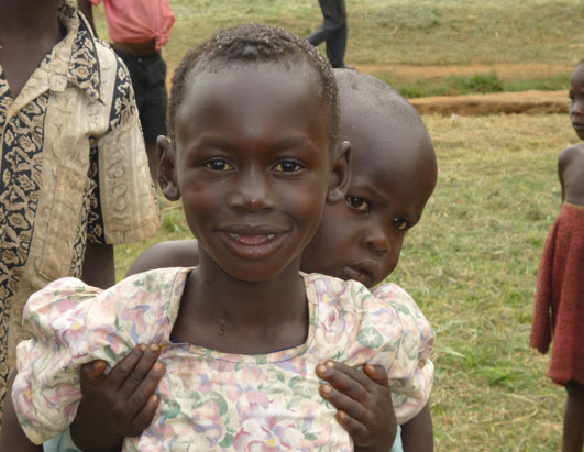 At the Awach IDP, an image far too familiar in Uganda -- children taking care of other children.