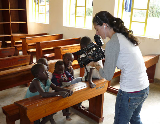 """Nightline"" producer Deborah Apton filmed  the story  story about  the Alderman Clinic in Uganda. Here, she  gets close-up video of children at the Laroo Boarding School."