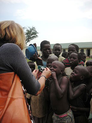 """Nightline"" correspondent Vicki Mabrey photographs children at  the Awach IDP camp.  Most of them have never seen a digital camera before and loved seeing themselves."