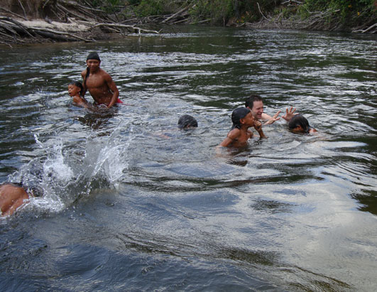 A pre-lunch swim for ABC News' Dan Harris and the tribal kids.