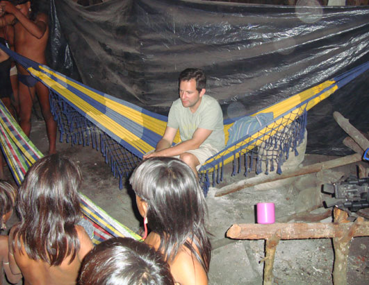 ABC News' Harris in the hut, sitting on one of the hammocks where we slept for three nights.
