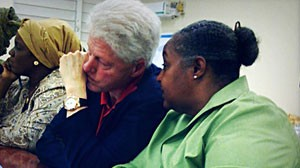 Former President Bill Clinton meets with Haitian women to discuss reconstruction.