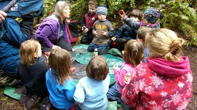 PHOTO Children attend a class at the Cedarsong Nature Forest Kindergarten on Vashon Island, Wash.