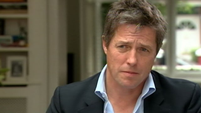 PHOTO:&nbsp;Actor Hugh Grant discusses the News of the World scandal, which he helped expose, with ABC's Jeffrey Kofman.