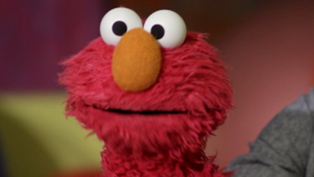 Behind the Face of Elmo
