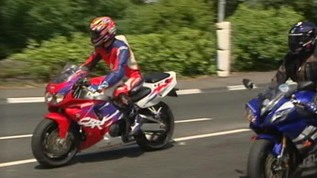 "PHOTO: ABCs Simon McGregor-Wood, in the red suit, took a ride on the Isle of Man TT race circuit on ""Mad Sunday,"" June 5, 2011."