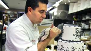 "PHOTO Buddy Valastro of TLC?s ""Cake Boss"" puts the finishes touches on his latest confectionary creation."