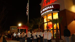 Avid following: Chick Fil-A fans in St. Petersburg, Fla., line up for a free meal before a new restaurant opens at the stroke of midnight. The celebratory campouts before Chick Fil-A openings evolved as customers hungry for chicken and fun started showing up earlier and earlier to take advantage of the chain's free meal deal.